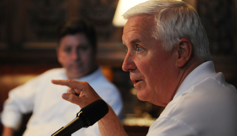 Pennsylvania Gov. Tom Corbett, right, along with Lt. Gov. Jim Cawley, left; hold a news conference in his chambers addressing the state budget-spending plan for the new fiscal year that starts in less than 40 hours, Sunday, June 29, 2014 in Harrisburg, Pa. (AP Photo/Bradley C Bower)