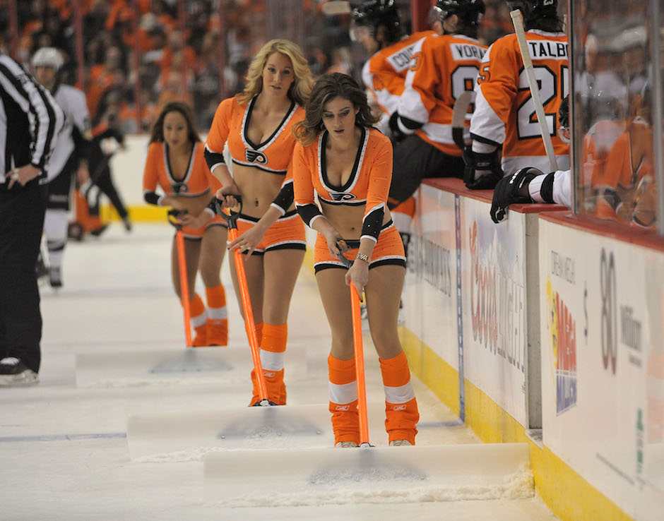 Members of the Philadelphia Flyers ice girls clean off the ice during a timeout against the Pittsburgh Penguins in the first period at the Wells Fargo Center on January 19, 2013. Photo | Eric Hartline-USA TODAY Sports