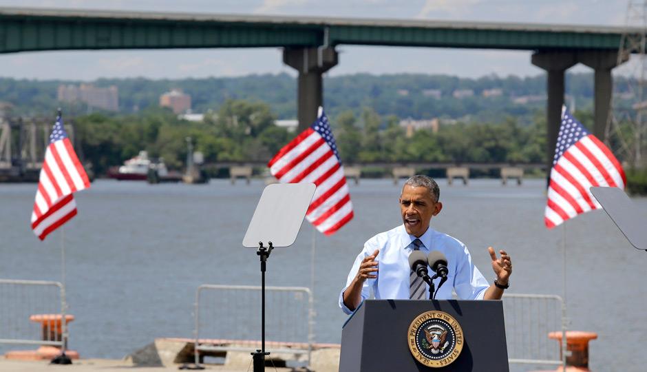 President Barack Obama speaks in front of the Interstate 495 bridge over the Christina River near Wilmington, Del. Photo | Patrick Semansky, AP