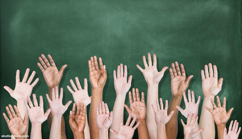 shutterstock_hands-raised-school-chalkboard-940x540