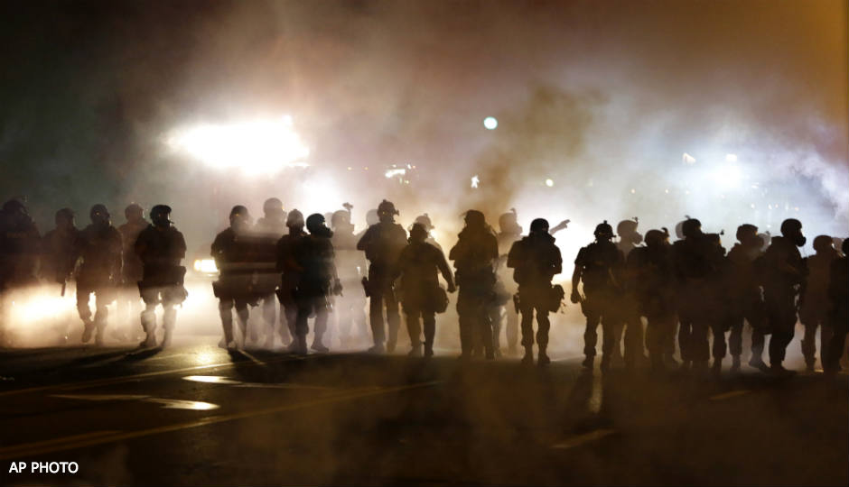 There were demonstrations and tear gas in Ferguson after the summertime shooting of Michael Brown by a police officer. A grand jury will announce that officer's fate today.