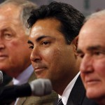 Philadelphia Phillies new general manager Ruben Amaro Jr. center, is flanked by outgoing GM Pat Gillick, left, and club president Dave Montgomery, right, duirng a news conference in Philadelphia Monday November 3, 2008. (AP Photo/ Joseph Kaczmarek)