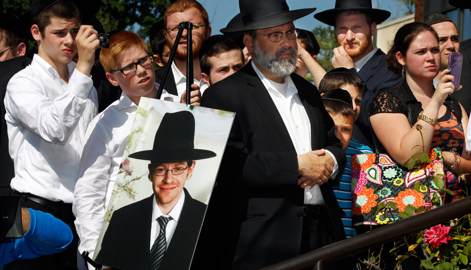 A photograph of Aaron Sofer, 23, is nearby as people listen during a news conference Tuesday, August 26, 2014, in Lakewood, N.J.  AP | Mel Evans
