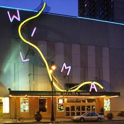The Wilma Theater lit up at night.