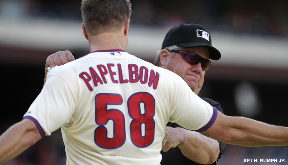 Philadelphia Phillies pitcher Jonathan Papelbon argues with Umpire Joe West after being ejected from the game against the Miami Marlins in the ninth inning of a baseball game Sunday, Sept. 14, 2014, in Philadelphia. The Marlins won 5-4.