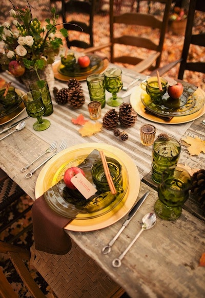 Pine cones, apples, and dark green accents make for the perfect fall table.