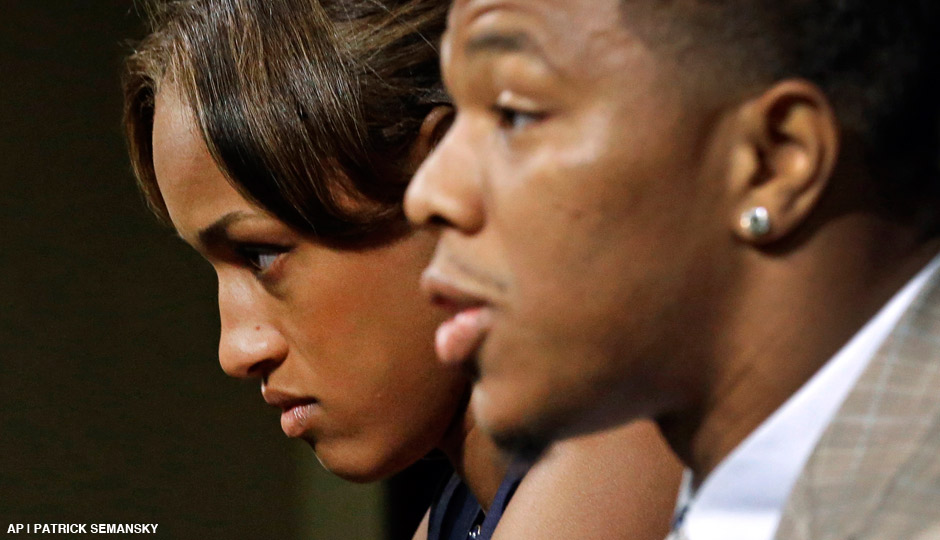 Janay Rice, left, looks on as her husband, Baltimore Ravens running back Ray Rice, speaks to the media during a news conference in Owings Mills, Md. on May 23rd, 2014.