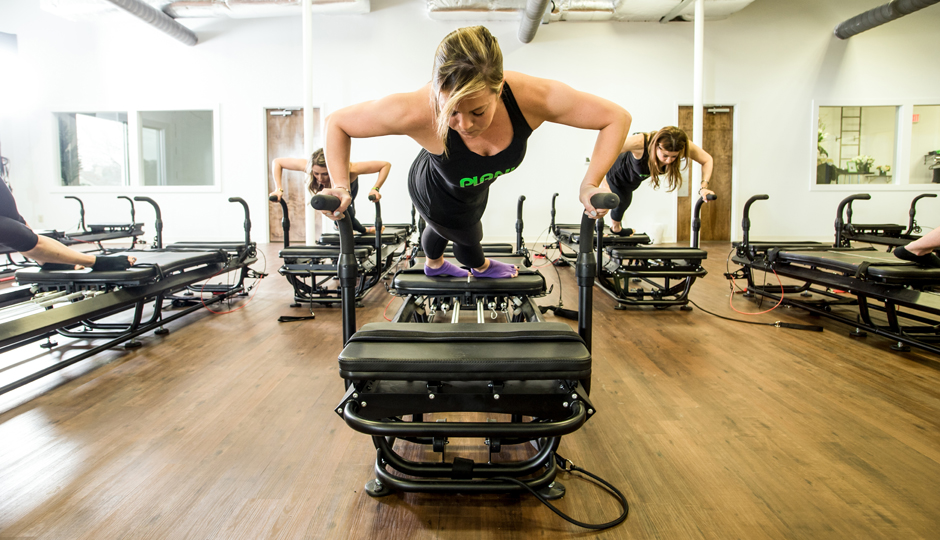 Classes at Plank Studio are performed on Megaformer machines. Photo via Plank.