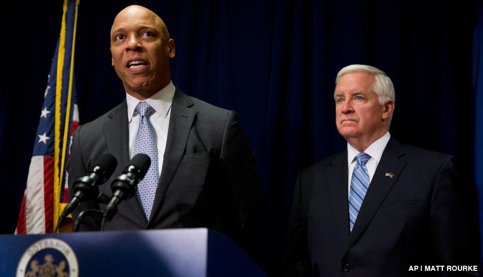 Philadelphia school district Superintendent William Hite, left, accompanied by Gov. Tom Corbett, speaks during a news conference Wednesday, Aug. 6, 2014, in Philadelphia.