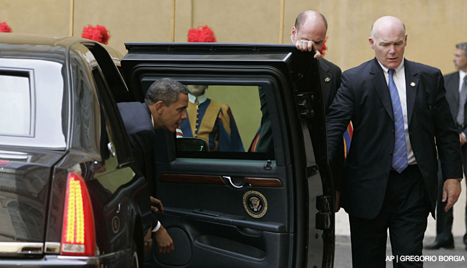 In this July 10, 2009 file photo, Secret Service Agent Joseph Clancy, right, holds the door open for President Barack Obama upon arrival at the Vatican for a meeting with Pope Benedict XVI. Secret Service Director Julia Pierson resigned Wednesday, a day after bitingly critical questioning by Congress about a White House security breach. There had been increasing calls for her departure during the day. Pierson will be replaced by Clancy, a former special agent in charge of the president's protective detail who retired in 2011.