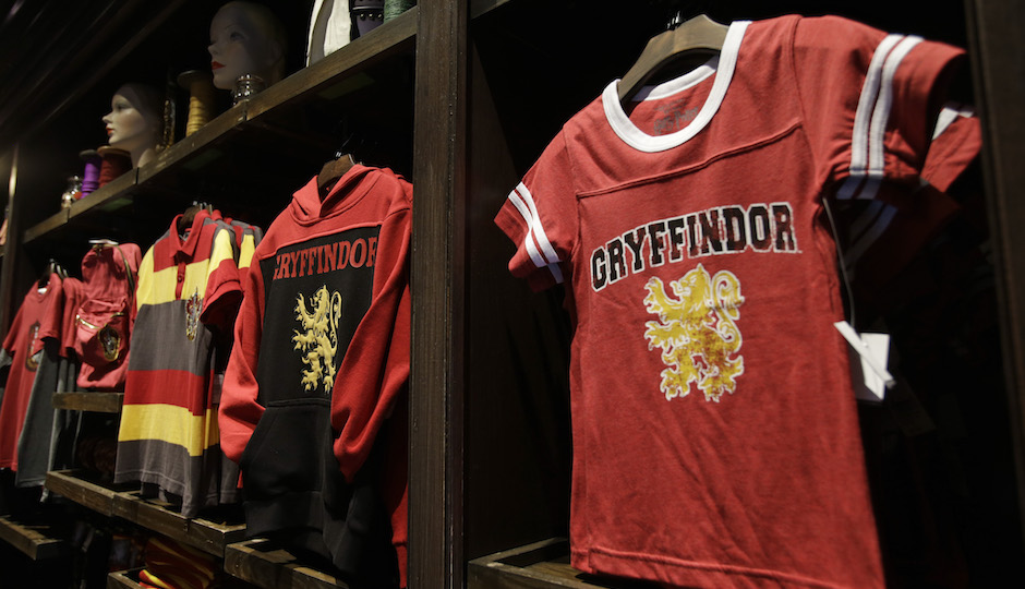 Gryffindor shirts for sale on display during a preview of Diagon Alley at the Wizarding World of Harry Potter at Universal Orlando, Thursday, June 19, 2014, in Orlando, Fla. (AP Photo/John Raoux)