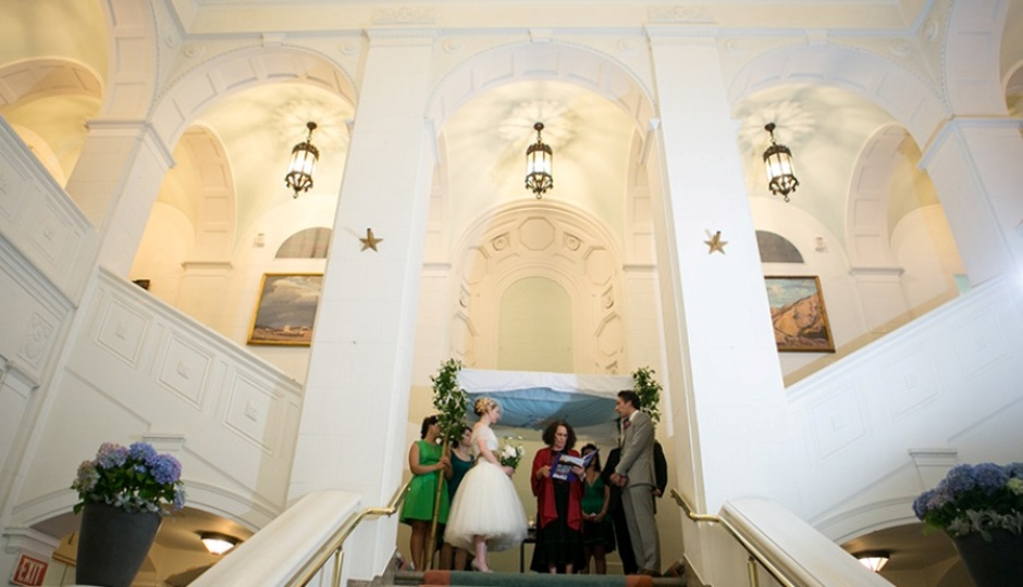Exchange vows at the top of the Swedish Museum's grand staircase. Photo by Peach Plum Pear Photography.
