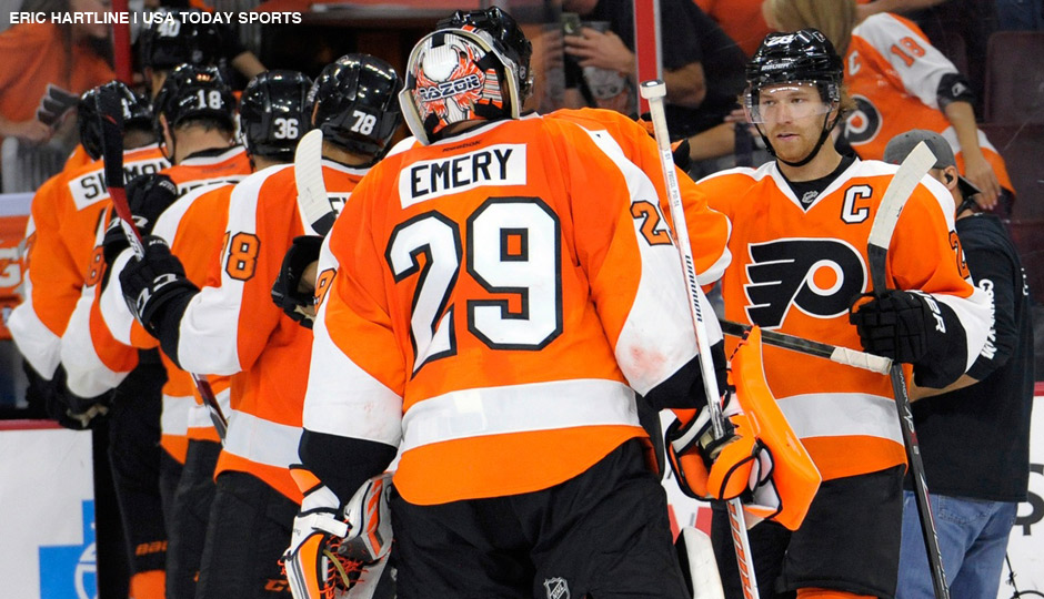 Sep 30, 2014: Philadelphia Flyers center Claude Giroux (28) celebrates with goalie Ray Emery (29) after defeating the New York Rangers, 4-2, at Wells Fargo Center.