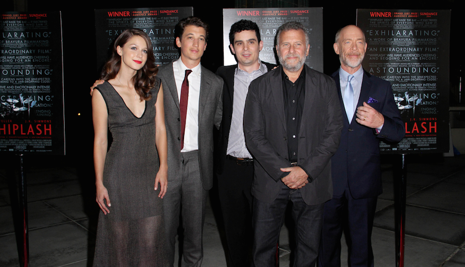 "Damien Chazelle (center) with the cast of ""Whiplash."" 