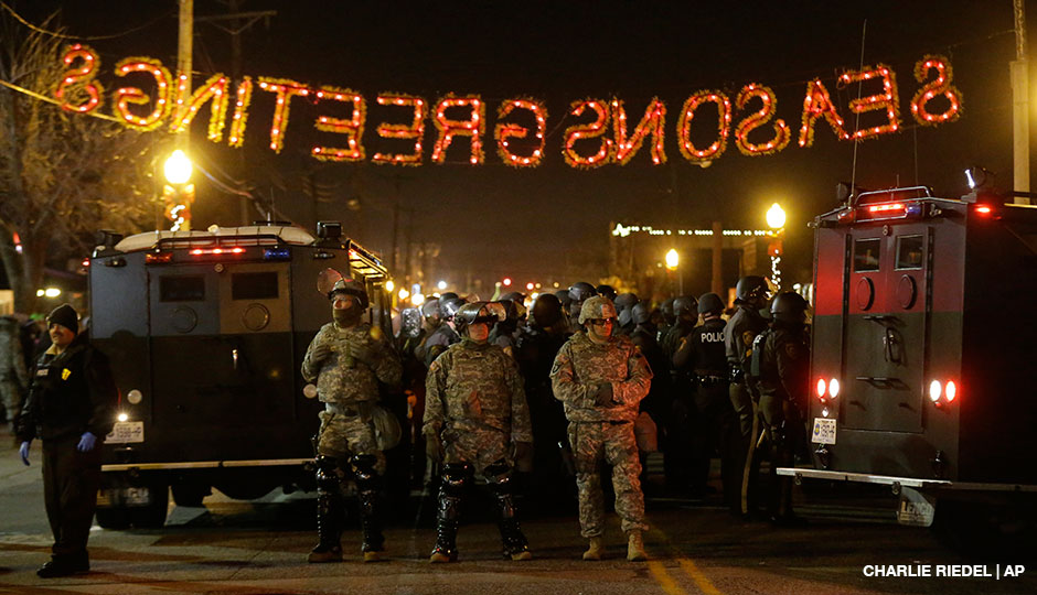National Guard stand in front of the Ferguson Police Department Tuesday, Nov. 25, 2014, in Ferguson, Mo. Missouri's governor ordered hundreds more state militia into Ferguson on Tuesday, after a night of protests and rioting over a grand jury's decision not to indict police officer Darren Wilson in the fatal shooting of Michael Brown, a case that has inflamed racial tensions in the U.S.