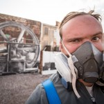 Artist Phillip Adams takes a mural selfie.