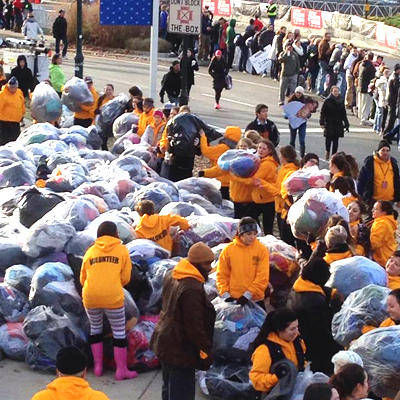 Volunteers collecting discarded clothing after the Philadelphia Marathon.