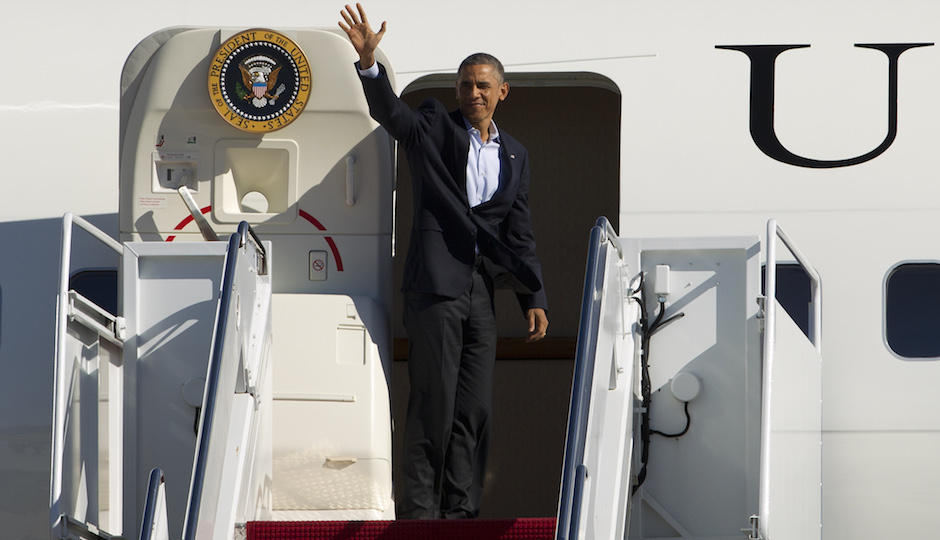 President Barack Obama waves from Air Force One, before departure at Andrews Air Force Base, Md., on Sunday, Nov. 2, 2014. Obama is traveling to Bridgeport, Conn., and later to Philadelphia, Pa., for a campaign events for gubernatorial democratic candidates in both states. (AP Photo/Jose Luis Magana)