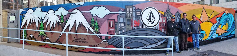 Volcom Muralist Eric Gordon stands between Bill Van Gilder (left) and Jeff Mattes (right) in front of Gordon's mural.