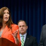 Attorney General Kathleen Kane gestures to Gov. Tom Corbett while speaking at a news conference in Harrisburg in June.