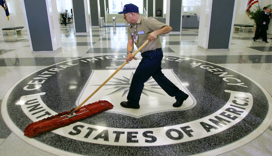 In this March 3, 2005 file photo, a workman slides a dustmop over the floor at the Central Intelligence Agency headquarters in Langley, Va. Senate investigators have delivered a damning indictment of CIA interrogation practices after the 9/11 attacks, accusing the agency of inflicting pain and suffering on prisoners with tactics that went well beyond legal limits. The torture report released Tuesday by the Senate Intelligence Committee says the CIA deceived the nation with its insistence that the harsh interrogation tactics had saved lives. It says those claims are unsubstantiated by the CIA's own records. (AP Photo/J. Scott Applewhite)