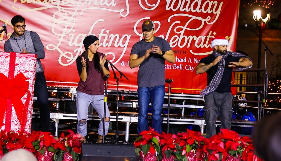 Angeles and the STOMP cast performing at the City Hall Christmas Tree Lighting.