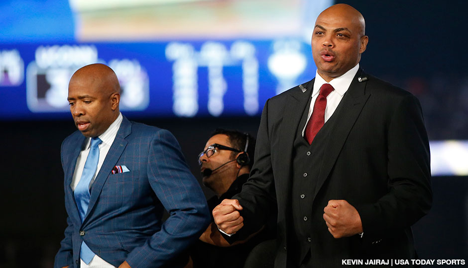 TV personalities Kenny Smith (left) and Charles Barkley watch action from their set during the championship game of the Final Four in the 2014 NCAA Mens Division I Championship tournament at AT&T Stadium.