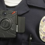 This Jan. 15, 2014 file photo a Los Angeles Police officer wears an on-body cameras during a demonstration for media in Los Angeles. Officers in one of every six departments around the country are now patrolling with these tiny cameras on their chests, lapels or sunglasses, and that number is growing. Most civil libertarians support their expansion despite concerns about the development of policies governing their use and their impact on privacy. (AP Photo/Damian Dovarganes,File)