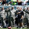 Chip Kelly with service members during the team's Military Appreciation Day in 2013. Photograph by Matt Rourke, AP