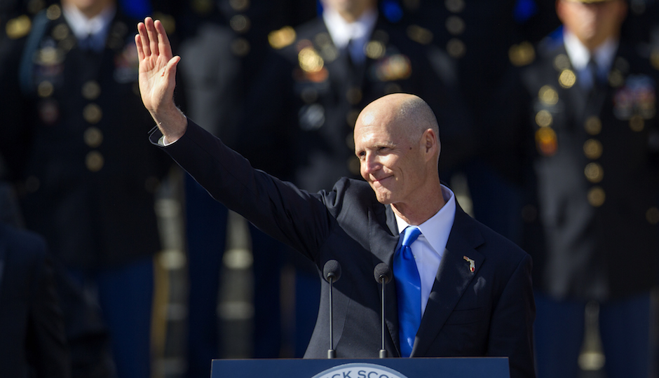 Florida Gov. Rick Scott waves after the swearing in for his second term as governor of Florida at the Florida state capitol in Tallahassee, Fla., Tuesday, Jan. 6, 2015. The inauguration took place in front of the Old Capitol. (AP Photo/Mark Wallheiser)