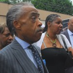 Reverend Al Sharpton with Esaw Garner, widow of Eric Garner, at a protest in the Staten Island neighborhood where Eric Garner died while in police custody. Photo: Thomas Good via Wikimedia Commons.