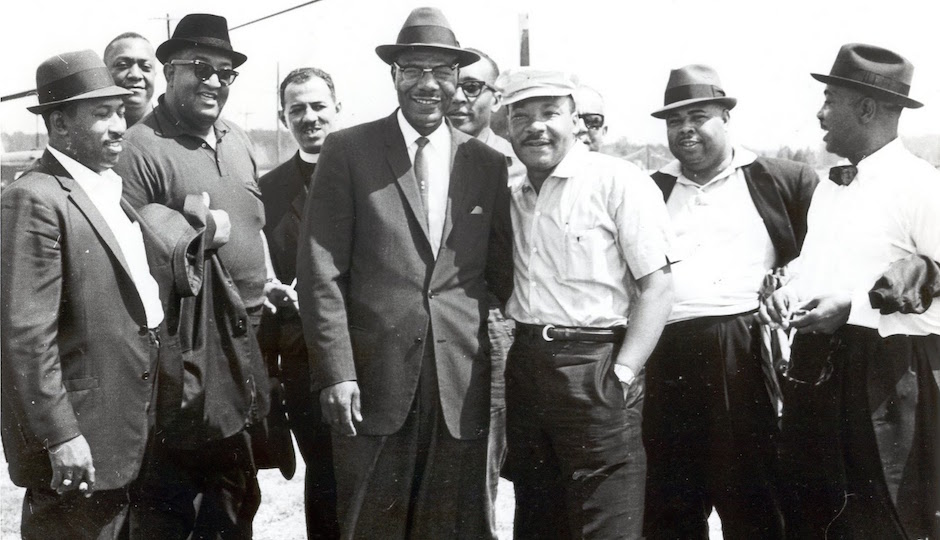 Dr. Martin Luther King Jr. poses with ministers from the Philadelphia delegation of the Selma to Motgomery Civil Rights March in 1965.