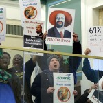 Demonstrators protest ahead of Mayor Nutter's budget address at City Hall in March 2013. AP photo/Matt Rourke
