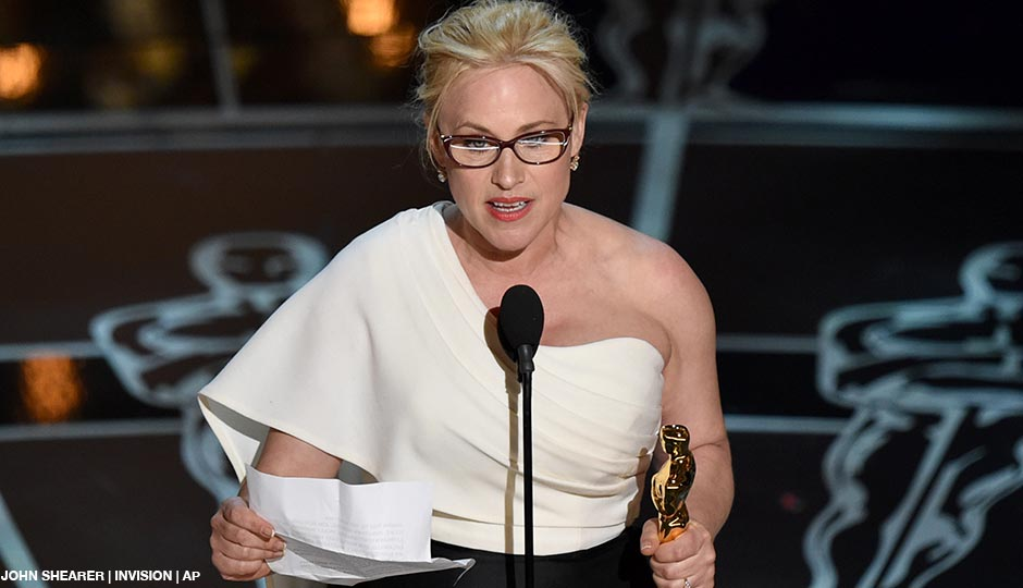 Patricia Arquette accepts the award for best actress in a supporting role for Boyhood at the Oscars on Sunday, Feb. 22, 2015, at the Dolby Theatre in Los Angeles.