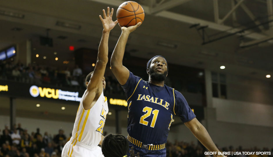 La Salle Explorers guard Jordan Price (21) shoots the ball as Virginia Commonwealth Rams guard Jordan Burgess (20) defends in the second half at Stuart Siegel Center. The Explorers won 74-69 in double overtime.