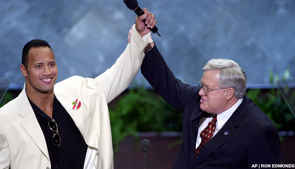 House Speaker Dennis Hastert and World Wrestling Federation champion The Rock raise their hands at the podium at the Republican National Convention in Philadelphia on August 2nd, 2000.