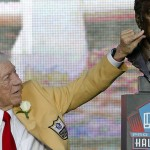 Ed Sabol touches his bust after  it was unveiled during the induction ceremony at the Pro Football Hall of Fame Saturday, Aug. 6, 2011, in Canton, Ohio. (AP Photo/Ron Schwane)