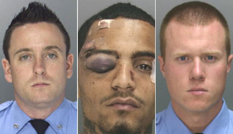 Officers Sean McKnight  (left) and Kevin Robinson (right); Najee Rivera (center)
