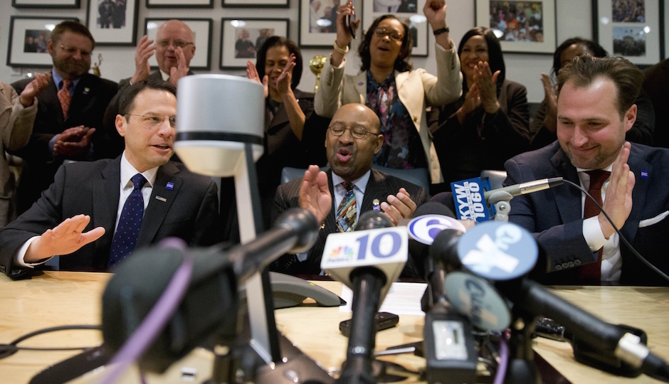Philadelphia Mayor Michael Nutter, center, reacts during a conference call with Democratic National Committee Chair Rep. Debbie Wasserman Schultz and other officials, Thursday, Feb. 12, 2015, at City Hall in Philadelphia. Democrats have selected Philadelphia as the site of the party's 2016 national convention, choosing a patriotic backdrop for the nomination of its next presidential candidate. The convention will be held the week of July 25, 2016  (AP Photo/Matt Rourke)