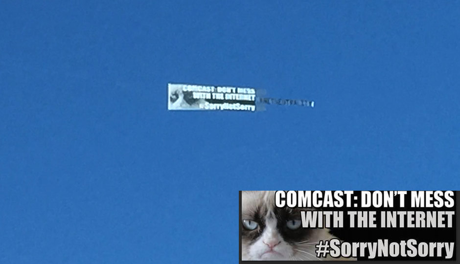 Above: The banner behind a plane flying around the Comcast Center today. Inset: A closeup of the message.