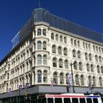 The next phase of digital signage atop Lit Bros. | Photo: Albert Stumm/Passyunk Post