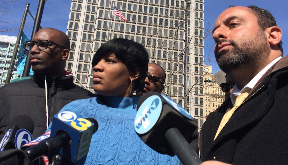 Tanya Dickerson, center, is flanked by Asa Khalif, left, and Brian Mildenberg, right, during a press conference on Thursday. Dickerson's son, Brandon Tate-Brown, was shot to death by police in December; DA Seth Williams announced earier in the day no charges would be filed in the death.