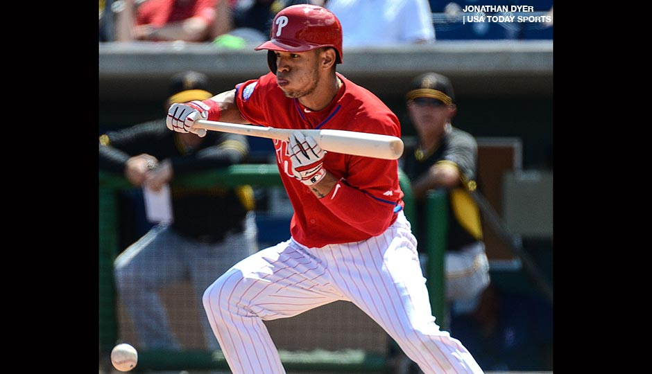 Philadelphia Phillies second baseman Cesar Hernandez (16) lays down a bunt in the first inning of the spring training game against the Pittsburgh Pirates at Bright House Field.