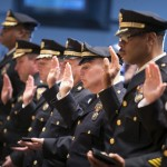 Members of the Philadelphia Police Department swear an oath during a Department promotion ceremony. | Copyright City of Philadelphia. Photograph by Mitchell Leff.