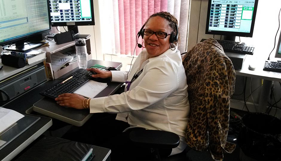 911 dispatcher Celestine Stanford at her desk inside the Police Administration Building, where she takes hundreds of calls each day. Photo | Christine O'Brien, Philadelphia Police Department