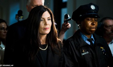 Attorney General Kathleen Kane walks from the State Supreme Court room, Wednesday, March 11, 2015, at City Hall in Philadelphia.
