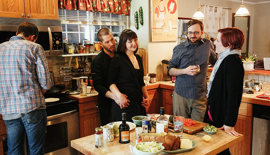 FAMILY DINNER: From left to right: Jon, Josh, Tiffany, Phillip and Mae cooking up dinner at Phillip and Tiffany's house in Bensalem. Photo | Gene Smirnov