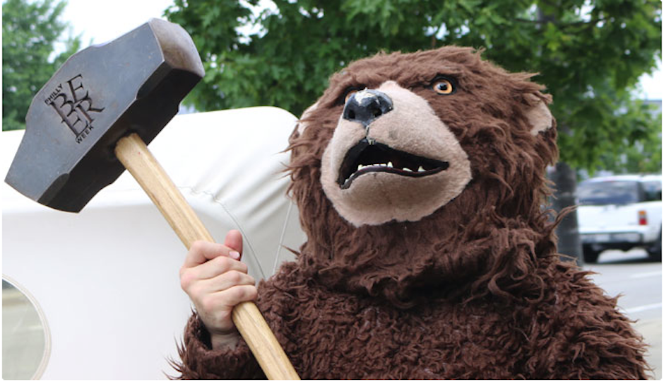 A very important photo of a bear holding the Hammer of Glory