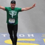 Montco dad Mike Rossi crosses the Boston Marathon finish line.
