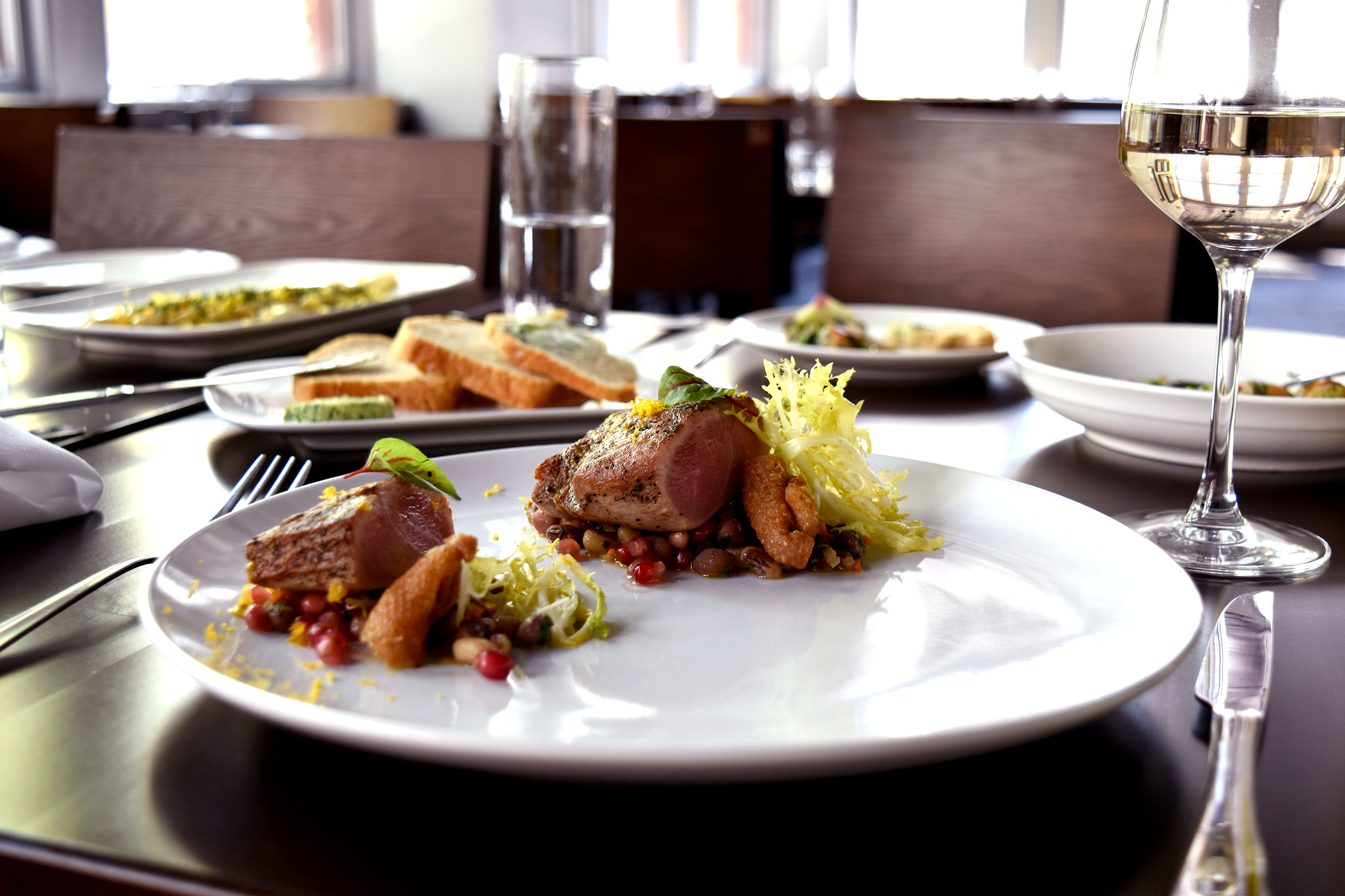 duck breast : heirloom beans : burnt orange vinaigrette : frisée